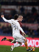 Calcio, Serie A: Roma vs Milan. Roma, stadio Olimpico, 12 dicembre 2016.<br /> Roma&rsquo;s Radja Nainggolan, right, kicks to score the winning goal as Milan's Manuel Locatelli tries to stop him during the Italian Serie A football match between Roma and AC Milan at Rome's Olympic stadium, 12 December 2016. Roma won 1-0.<br /> UPDATE IMAGES PRESS/Isabella Bonotto
