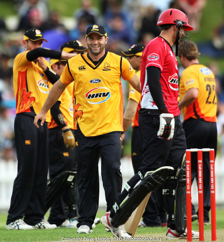 Wellington's Luke Woodcock grins at Andrew Ellis after Carl Frauenstein's dismissal during the HRV Cup Twenty20 cricket match between the Wellington Firebirds and Canterbury Wizards at Allied Nationwide Finance Basin Reserve, Wellington, New Zealand on Wednesday, 6 January 2010. Photo: Dave Lintott / lintottphoto.co.nz