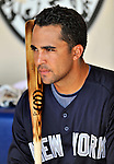 8 March 2011: New York Yankees' catcher Gustavo Molina sits in the dugout prior to a Spring Training game against the Atlanta Braves at Champion Park in Orlando, Florida. The Yankees edged out the Braves 5-4 in Grapefruit League action. Mandatory Credit: Ed Wolfstein Photo