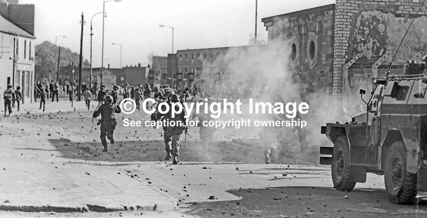 Snatch squad of British soldiers chase stone-throwing rioters during street disorders in the Bogside area of Londonderry, N Ireland, 9th July 1971. The rioting was prompted by the deaths of two local men, Seamus Cusack and Desmond Beattie, who were shot by soldiers in disputed circumstances. 197107090261d<br /> <br /> Copyright Image from Victor Patterson, 54 Dorchester Park, Belfast, UK, BT9 6RJ<br /> <br /> Tel: +44 28 9066 1296<br /> Mob: +44 7802 353836<br /> Voicemail +44 20 8816 7153<br /> Email: victorpatterson@me.com<br /> Email: victorpatterson@gmail.com<br /> <br /> IMPORTANT: My Terms and Conditions of Business are at www.victorpatterson.com