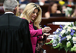Nevada Supreme Court Chief Justice James Hardesty watches as Assemblywoman Michele Fiore, R-Las Vegas, signs her certificate of election during opening day ceremonies at the Legislative Building in Carson City, Nev., on Monday, Feb. 2, 2015. Fiore's grandson Jake Willis, 4, plays beside her. (Cathleen Allison/Las Vegas Review-Journal)