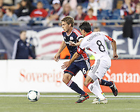 New England Revolution midfielder Scott Caldwell (6) dribbles as D.C. United midfielder John Thorrington (8) closes. In a Major League Soccer (MLS) match, the New England Revolution (blue) defeated D.C. United (white), 2-1, at Gillette Stadium on September 21, 2013.