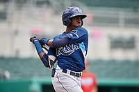 GCL Rays left fielder Yunior Martinez (1) follows through on a swing during a game against the GCL Red Sox on August 1, 2018 at JetBlue Park in Fort Myers, Florida.  GCL Red Sox defeated GCL Rays 5-1 in a rain shortened game.  (Mike Janes/Four Seam Images)