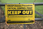 HACCP Disease Precautions Critical Control Point yellow sign on field gate, Suffolk, England, 2007