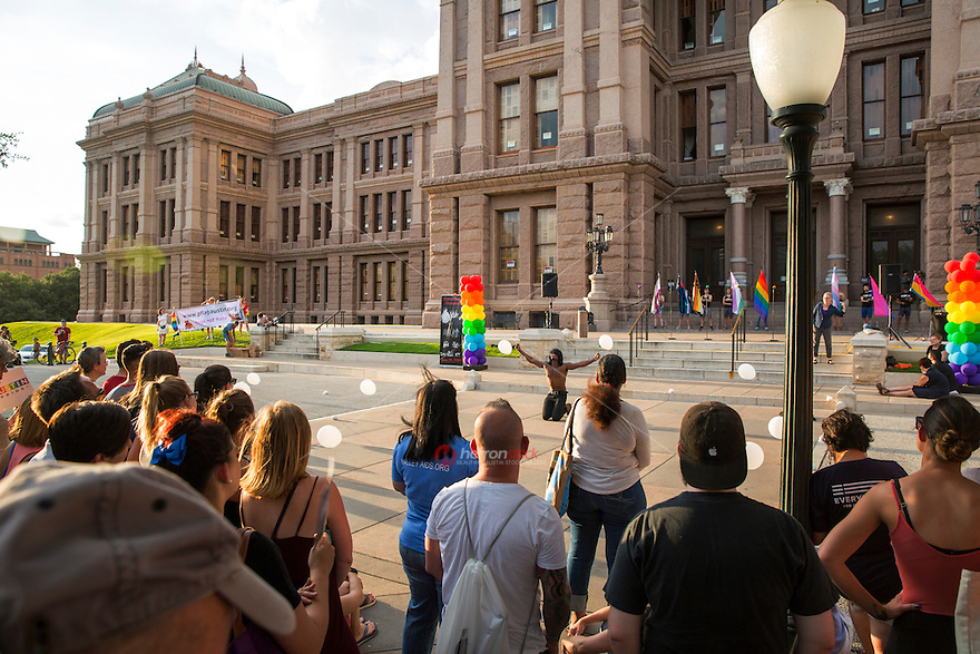 AUSTIN, TEXAS - A performer dances on the South steps of the Texas State Capitol on Saturday, Aug. 23, 2016 for the 5th Annual Stonewall Rally in observance of the 46th anniversary of the Stonewall Riots. The Stonewall Celebration pays tribute to the individuals that sparked the modern day gay rights movement in June 1969 at the Stonewall Inn on Saturday, Aug. 23, 2016. This event is sponsored by The Austin Gay & Lesbian Pride Foundation (AGLPF), Transgender Education Network of Texas, and Equality Texas.<br />