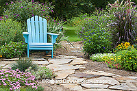 63821-19413 Flower garden with  path and blue chair. Tapien pink verbena, butterfly bush, calibrachoa, sedum, fescue IL