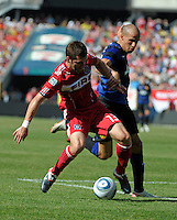 Manchester United midfielder Gabriel Obertan (26) pressures Chicago Fire defender Gonzalo Segares (13).  Manchester United defeated the Chicago Fire 3-1 at Soldier Field in Chicago, IL on July 23, 2011.