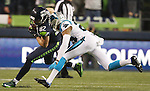 Seattle Seahawks tight end Luke Willson (82) is run down by Carolina Panthers cornerback Josh Norman (24) in the NFC Western Division Playoffs at CenturyLink Field  on January 10, 2015 in Seattle, Washington. The Seahawks beat the Panthers 31-17. ©2015. Jim Bryant Photo. All Rights Reserved.