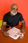 Mature African American man sitting at cafe table, portrait
