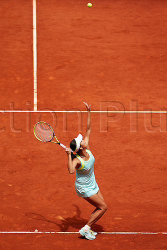 07.05.2014 Madrid, Spain. Shuai Peng of China serves during the game with Serena Williams of USA on day 4 of the Madrid Open from La Caja Magica.