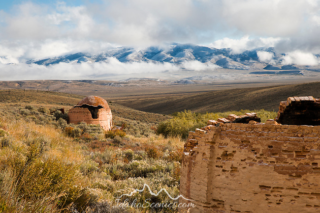 Idaho, Central, Leadore, Lime KIln remains in the Birch Creek Valley with the snow capped Bitterroot Range and morning autumn mists.