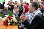 """Palestinians celebrate engagement of a 32-year-old Palestinian groom Mosa'ab Obaid, and his 21-year-old bride Lina Shalaldeh, at the protest village of """"Ahfad Younis"""" in Eizariya east Jerusalem, on March 23, 2013. Hundreds of the Palestinians arrived on Wednesday to Eizariya and erected about 15 tents on lands of the village as new neighborhood of Bab al Shams village called Ahfad Younis """"Younis' Grandchildren"""". Residents of the new neighborhood of Bab Al-Shams invite Palestinians to join the village and participate in maintaining its steadfastness. Photo by Issam Rimawi"""