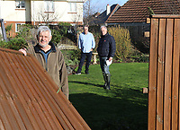 BNPS.co.uk (01202 558833)<br /> Pic: CorinMesser/BNPS<br /> <br /> Three neighbours who all lost fences l to r Stephen Powell , Dave Thorne and Martin Young.<br /> <br /> Homeowners are counting the cost today after a 'tornado' hit a south coast town overnight.<br /> <br /> Residents in Barton-on-Sea, Hants, were woken at 4am as the twister blasted its way through the town like an 'express train'. <br /> <br /> The strength of the winds of up to 80mph shook numerous houses, sending roof tiles smashing to the ground.<br />  <br /> A 30ft long brick wall collapsed under the strength of the gusts while fence panels were flung through the air.<br /> <br /> Part of a garden shed that had been picked up by the tornado smashed a hole through the windscreen of a car.