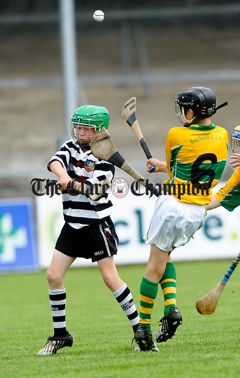 Feakle/Killanena's Martin Daly moves to tackle Clarecastle's Jack Murphy during their U-12B final at Cusack Park. Photograph by John Kelly.