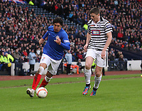 Francisco Sandaza takes on Paul Gallacher in the Queen's Park v Rangers Irn-Bru Scottish League Division Three match played at Hampden Park, Glasgow on 29.12.12.