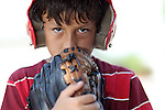 Young serious baseball boy with red helmet