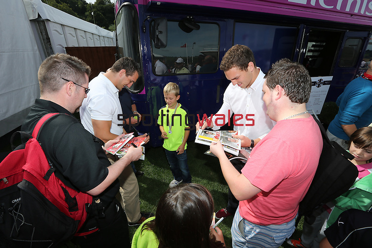 ISPS Handa Wales Open 2013<br /> Celtic Manor Resort<br /> Sam Warburton &amp; George North signing autographs in the tented village.<br /> 01.09.13<br /> <br /> &copy;Steve Pope-Sportingwales