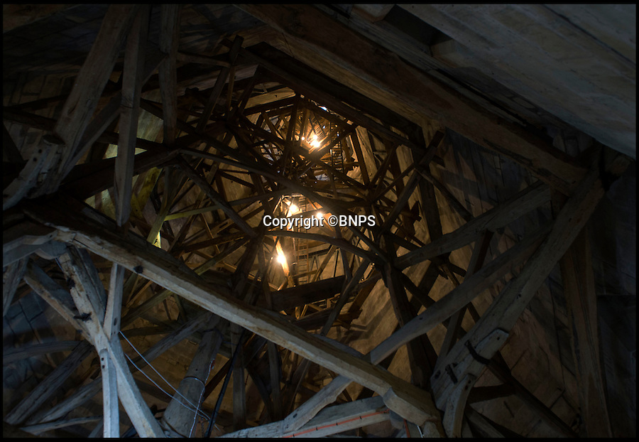 BNPS.co.uk (01202 558833)<br /> Pic: PhilYeomans/BNPS<br /> <br /> Before it was hard to make out the wooden framework of the spire in the gloom.<br /> <br /> Let there be light...generous volunteer reveals medieval marvel for the first time in its history.<br /> <br /> A dedicated cathedral tour guide has dipped in to his own pocket to pay for the installation of lights to illuminate the inside of Britain's tallest spire for the first ever time.<br /> <br /> Robert Stiby, 79, has been a lifelong admirer of Salisbury Cathedral in Wiltshire, but after spending the last eight years guiding visitors up the 330 steps to the spire he became frustrated by the lack of light to reveal its true glory.<br /> <br /> The full extent of its amazing medieval feat of engineering could barely be seen in the gloom, until Robert splashed out £5000 of his own money to install 24 LED lights to reveal the oak structure that holds up the final 180ft of its needle like spire.