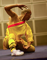 Monks from the Shaolin temple, Henan, China, performing martial arts feats