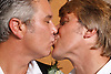 Two men kissing at their Civil Ceremony