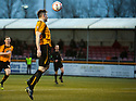 Alloa's Ben Gordon lobs a header into the net to score Alloa's late equaliser.