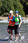 NELSON LAKES, NEW ZEALAND - APRIL 18:  Nicki Robinson gets a helping hand as she crosses the Travers River during the 2015 Alpine Lodge Loop The Lake trail run at Lake Rotoiti on April 18 16, 2015 in Nelson, New Zealand. (Photo by Marc Palmano/Shuttersport Limited)