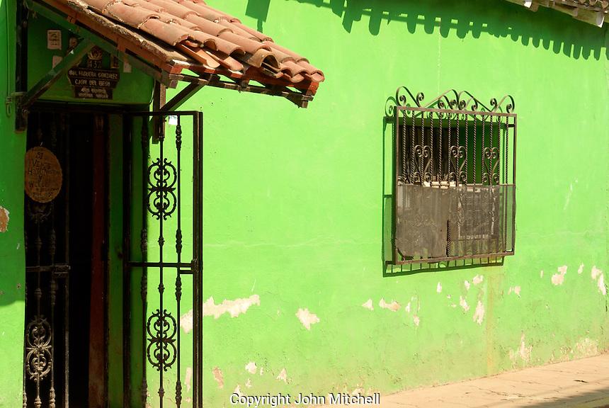 Lime green facade of a restored house in the town of El Quelite near  Mazatlan, Sinaloa, Mexico
