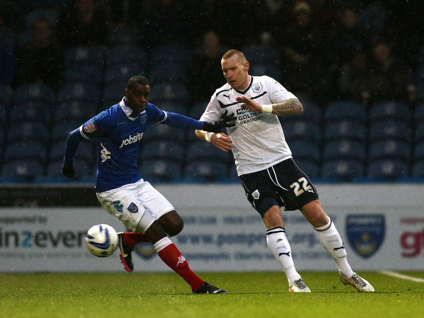 Preston North End's Jack King and Portsmouth's Izale McLeod in action during todays match  ..Football - npower Football League Division One - Portsmouth v Preston North End - Saturday 15th December 2012 - Fratton Park - Portsmouth..