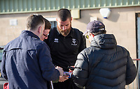 Lincoln City's Michael Bostwick signs autographs for fans after arriving at the ground<br /> <br /> Photographer Chris Vaughan/CameraSport<br /> <br /> The EFL Sky Bet League Two - Lincoln City v Stevenage - Saturday 16th February 2019 - Sincil Bank - Lincoln<br /> <br /> World Copyright © 2019 CameraSport. All rights reserved. 43 Linden Ave. Countesthorpe. Leicester. England. LE8 5PG - Tel: +44 (0) 116 277 4147 - admin@camerasport.com - www.camerasport.com