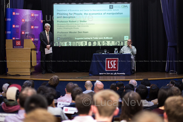 London, 11/11/2015. Today, LSE presented a public lecture - part of the Department of Economics and Centre for Macroeconomics public lecture - called &quot;Phishing for Phools: the economics of manipulation and deception&quot; hosted by the author of the homonymous book (written with George A. Akerlof), Robert J. Shiller (American Nobel Laureate, economist, academic &amp; author; he currently Sterling Professor of Economics at Yale University &amp; he is a fellow at the Yale School of Management's International Center for Finance; he has been a research associate of the National Bureau of Economic Research, NBER, since 1980; he is ranked among the 100 most influential economists of the world; Eugene Fama, Lars Peter Hansen &amp; Shiller jointly received the 2013 Nobel Memorial Prize in Economic Sciences, &quot;for their empirical analysis of asset prices&quot;). Chair of the event was Wouter Den Haan (Professor of Economics at LSE &amp; Co-Director of the Centre for Macroeconomics). From the event online page: &lt;&lt;Ever since Adam Smith, the central teaching of economics has been that free markets provide us with material well-being, as if by an invisible hand. Robert Shiller delivers a fundamental challenge to this insight, arguing that markets harm as well as help us. As long as there is profit to be made, sellers will systematically exploit our psychological weaknesses and our ignorance through manipulation and deception. Rather than being essentially benign and always creating the greater good, markets are inherently filled with tricks and traps and will &quot;phish&quot; us as &quot;phools.&quot; This represents a radically new direction in economics, [&hellip;] It thereby explains a paradox: why, at a time when we are better off than ever before in history, all too many of us are leading lives of quiet desperation. [&hellip;]&gt;&gt;. (http://bit.ly/1WVMGN7)<br /> <br /> Here there is the link to podcast and video of the lecture: http://bit.ly/1j3cfZU