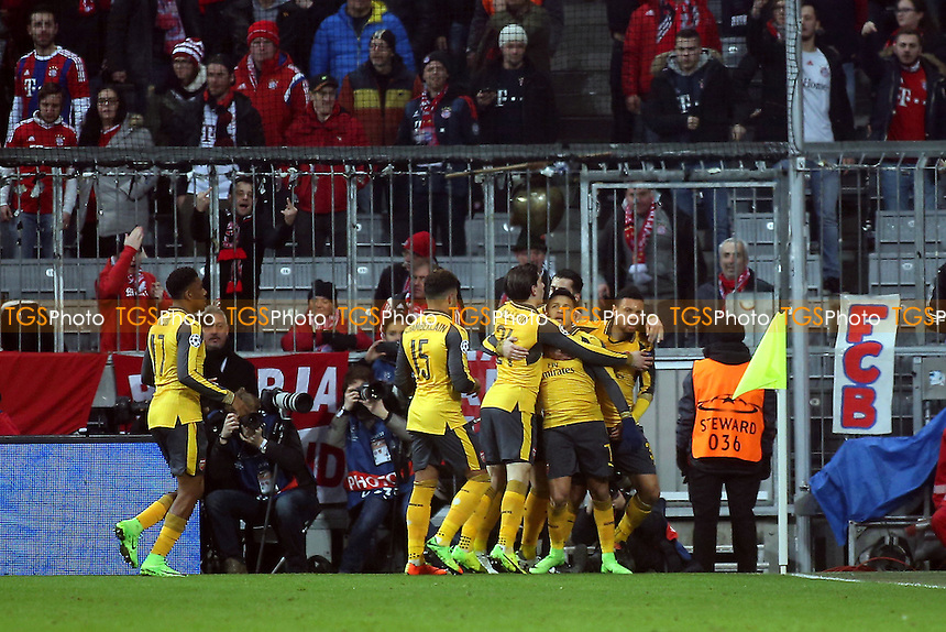 Arsenal players congratulate Alexis Sanchez after scoring Arsenal's opening goal during FC Bayern Munich vs Arsenal, UEFA Champions League Football at the Allianz Arena on 15th February 2017