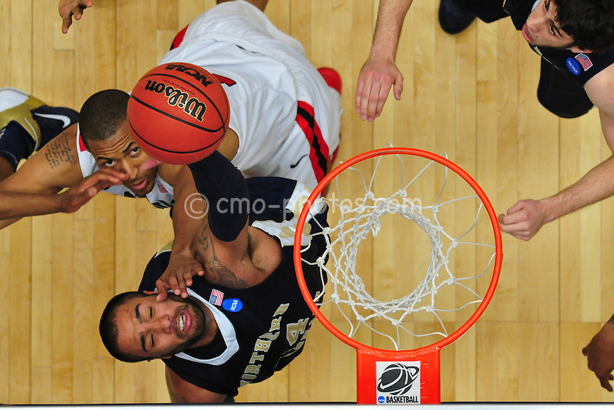 Mar 17, 2011; Tucson, AZ, USA; Northern Colorado Bears center Kevin Hanes (4) is hit in the face while shooting in the second half of a game against the San Diego State Aztecs in the second round of the 2011 NCAA men's basketball tournament at the McKale Center. The Aztecs won 68-50.