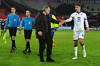 Steve Cooper Head Coach of Swansea City shakes the hand of Ben Cabango of Swansea City at full time during the Sky Bet Championship match between Swansea City and Blackburn Rovers at the Liberty Stadium in Swansea, Wales, UK. Wednesday 11 December 2019