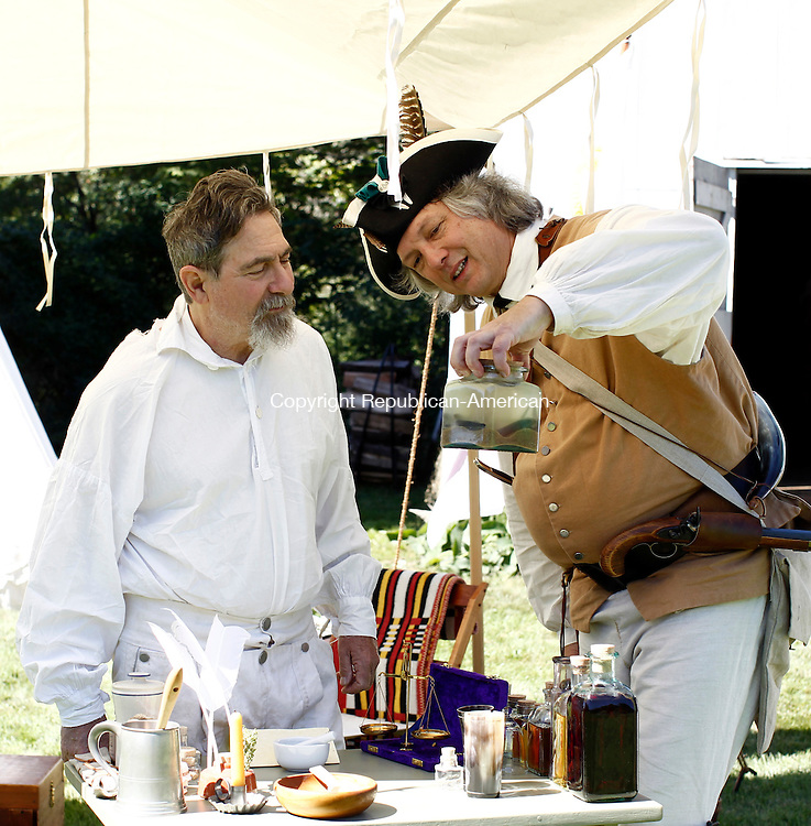 Woodbury, CT- 14 September 2014-091414CM04- Dane Deleppo, left, of Harwinton and Ken Buckbee talk about camp apothecary during the 20th annual Colonial Fair and Muster Day at the Hurd House in Woodbury on Sunday. The lawn of the historic home featured members of the Trumbull-Porter Chapter of the Daughters of the American Revolution, members of The Great Quinnehtukqut Company of Artificers and Traders portraying their work with tools and fabrics. The Gov. Oliver Wolcott Sr. Branch of the Sons of the American Revolution also performed and portrayed an encampment of civilians and soldiers.   Christopher Massa Republican-American