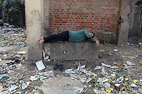 A man sleeps in the street in central Kolkata.<br /> <br /> To license this image, please contact the National Geographic Creative Collection:<br /> <br /> Image ID: 1925777 <br />  <br /> Email: natgeocreative@ngs.org<br /> <br /> Telephone: 202 857 7537 / Toll Free 800 434 2244<br /> <br /> National Geographic Creative<br /> 1145 17th St NW, Washington DC 20036