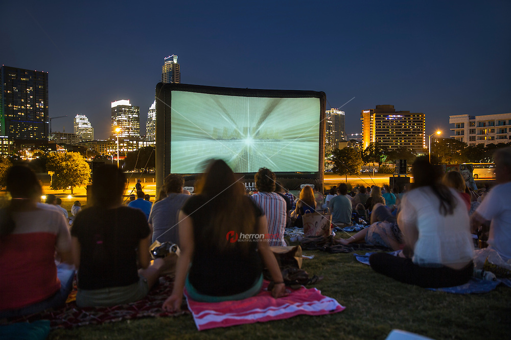 Summers entertainment in Austin include free outdoors concert and movie series held on the lawn. Night time. View from behind - Stock image.