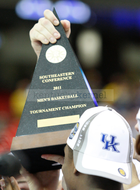 The University of Kentucky basketball team holds up the championship trophy of the 2011 SEC Tournament after defeating Florida 70-54, at the Georgia Dome, Sunday, March 13, 2011.  Photo by Latara Appleby | Staff