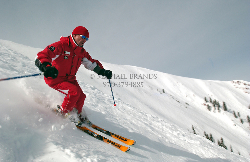 Ski instructor Paul Wade enjoys a lap through the bowl at Aspen Highlands, CO. © Michael Brands. 970-379-1885.