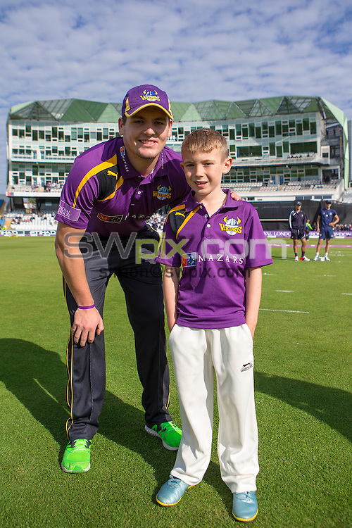 Picture by Alex Whitehead/SWpix.com - 06/09/2015 - Cricket - Royal London One-Day Cup, Semi-Final - Yorkshire CCC v Gloucestershire CCC - Headingley Cricket Ground, Leeds, England - Yorkshire captain Alex Lees with mascot.