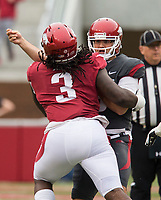 Hawgs Illustrated/BEN GOFF <br /> Ben Hicks, Arkansas quarterback, gets rid of the ball under pressure from McTelvin Agim, Arkansas defensive lineman, in the first quarter Saturday, April 6, 2019, during the Arkansas Red-White game at Reynolds Razorback Stadium.