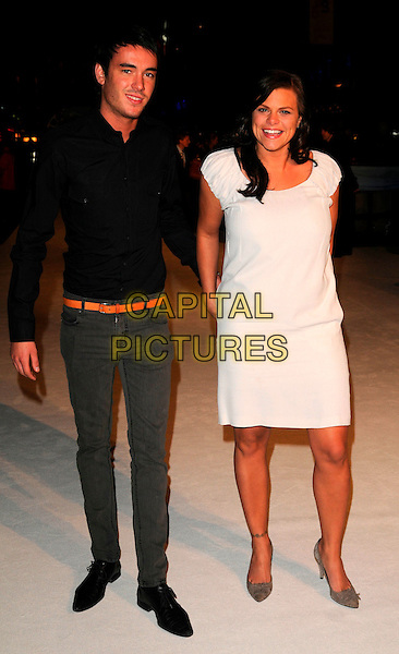 "JACK TWEEDY & JADE GOODY.""The Accidental Husband"" UK film premiere, Vue West End, London, England..February 13th 2008.full length white dress tanned black shirt couple .CAP/CAN.©Can Nguyen/Capital Pictures."