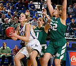 SIOUX FALLS, SD - NOVEMBER 29: Tagyn Larson #24 from South Dakota State looks to the basket past Jen Wellnitz #1 and Madison Wolf #52 from Wisconsin Green Bay during their game Thursday night at Frost Arena in Brookings. (Photo by Dave Eggen/Inertia)