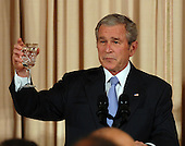 Washington, D.C. - November 26, 2007 -- United States President George W. Bush offers a toast during a dinner at the State Department in Washington on the eve of a Middle East peace conference on November 26, 2007. Bush, Palestinian President Mahmoud Abbas and Israeli Prime Minister Ehud Olmert are among the participants. .Credit: Roger L. Wollenberg - Pool via CNP