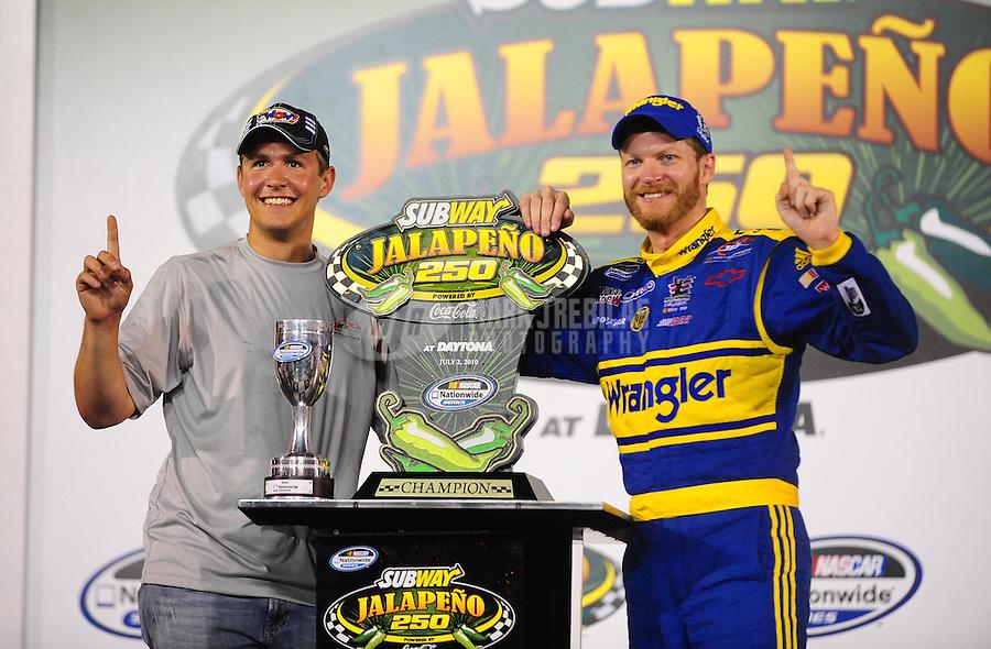 Jul. 2, 2010; Daytona Beach, FL, USA; NASCAR Nationwide Series driver Dale Earnhardt Jr (right) celebrates with Steve Arpin in victory lane after winning the Subway Jalapeno 250 at Daytona International Speedway. Mandatory Credit: Mark J. Rebilas-