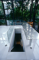 In the glass-walled salon to the rear of the house a staircase and stainless steel table arranged with the perfect symmetry which is a hallmark of Hiroshi Hara's architectural philosophy