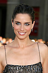 """Actress Amanda Peet arrives at the The World Premiere of """"The X-Files: I Want To Believe"""" at Mann's Grauman Chinese Theatre on July 23, 2008 in Hollywood, California."""