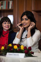 Kathryn Deyell (DFAT) (left) listens as Pallavi Sharda (OzFest ambassador) hold her earrings while speaking during a press conference on Oz Fest in Raj Mahal Palace hotel, Jaipur, India on 10th January 2013. Photo by Suzanne Lee/DFAT