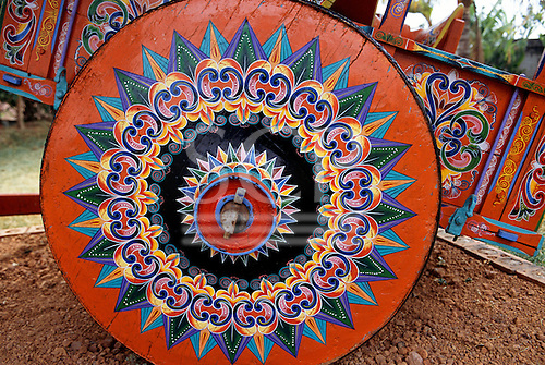 Sarchi, Costa Rica. Design on ox cart in the workshop of artist Carlos Chaverri; painting ox carts 70 years since he was 7.