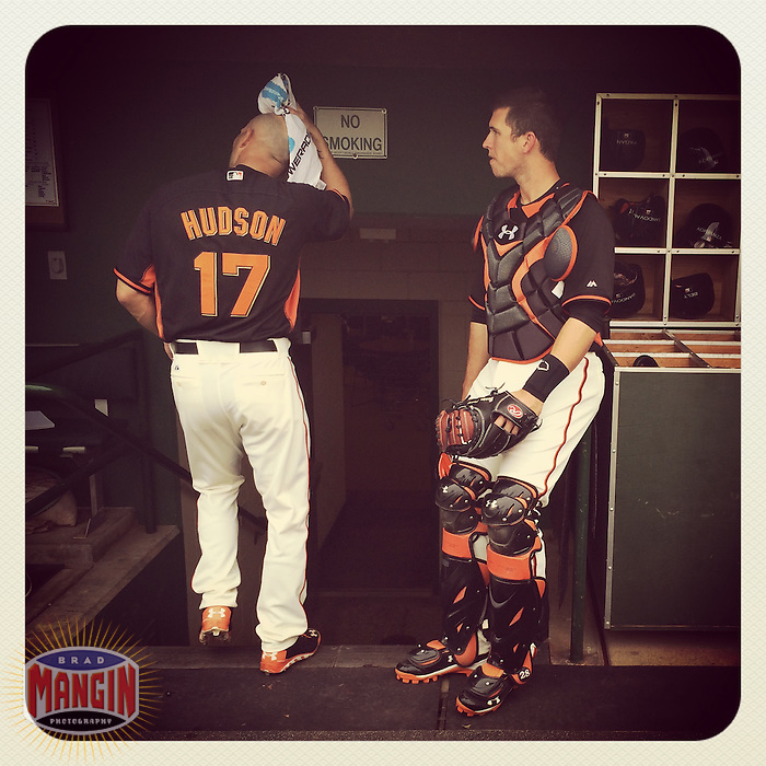SCOTTSDALE, AZ - MARCH 6: Instagram of Tim Hudson and Buster Posey of the San Francisco Giants getting ready in the dugout before a spring training game at Scottsdale Stadium on March 6, 2014 in Scottsdale, Arizona. Photo by Brad Mangin