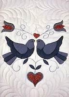 The close-up of a quilt shows the loving dove design. Lancaster Pennsylvania United States quilt store.